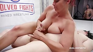 Bella Rossi mixed sex wrestling gives a handjob then Strapon Pounds the dummy