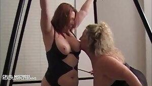 Mature Lesbian Mistress fists her pretty slave