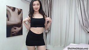 Brunette Asian unwrapping on webcam