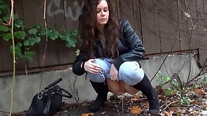 Shy Brunette Tries Public Pissing